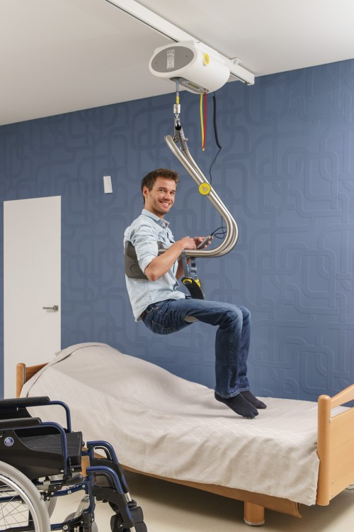 Handi-Move - Ceiling motor - Self-transferring from wheelchair to bed - SureHands® Body Support , Ceiling motor