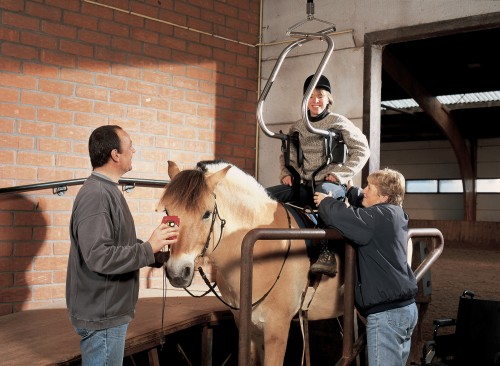 Horseback riding with the Handi-Move body support and the ceiling motor